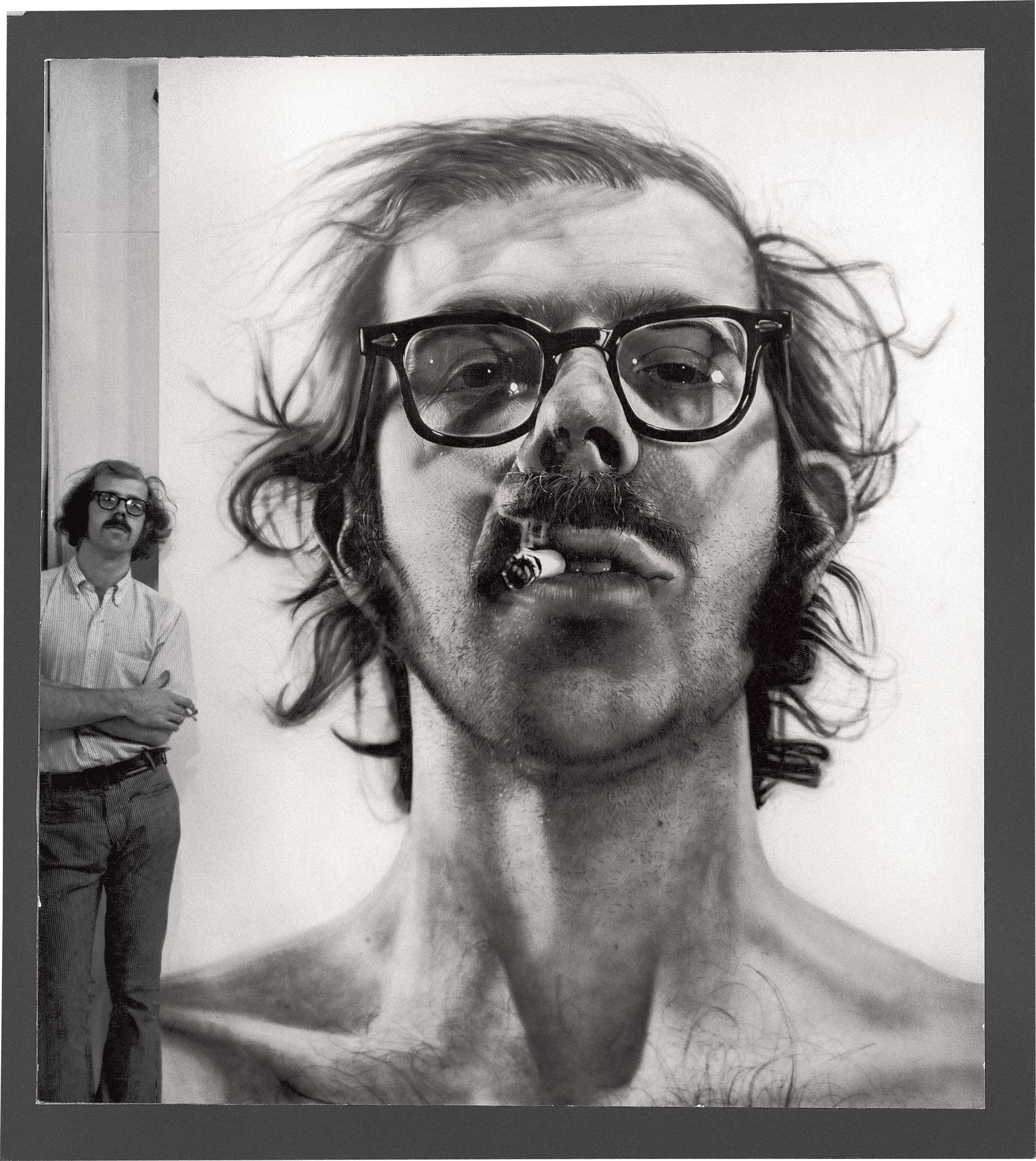 Chuck Close with 'Big Self-Portrait' in his studio, 1968 (Photo by Kenny Lester)