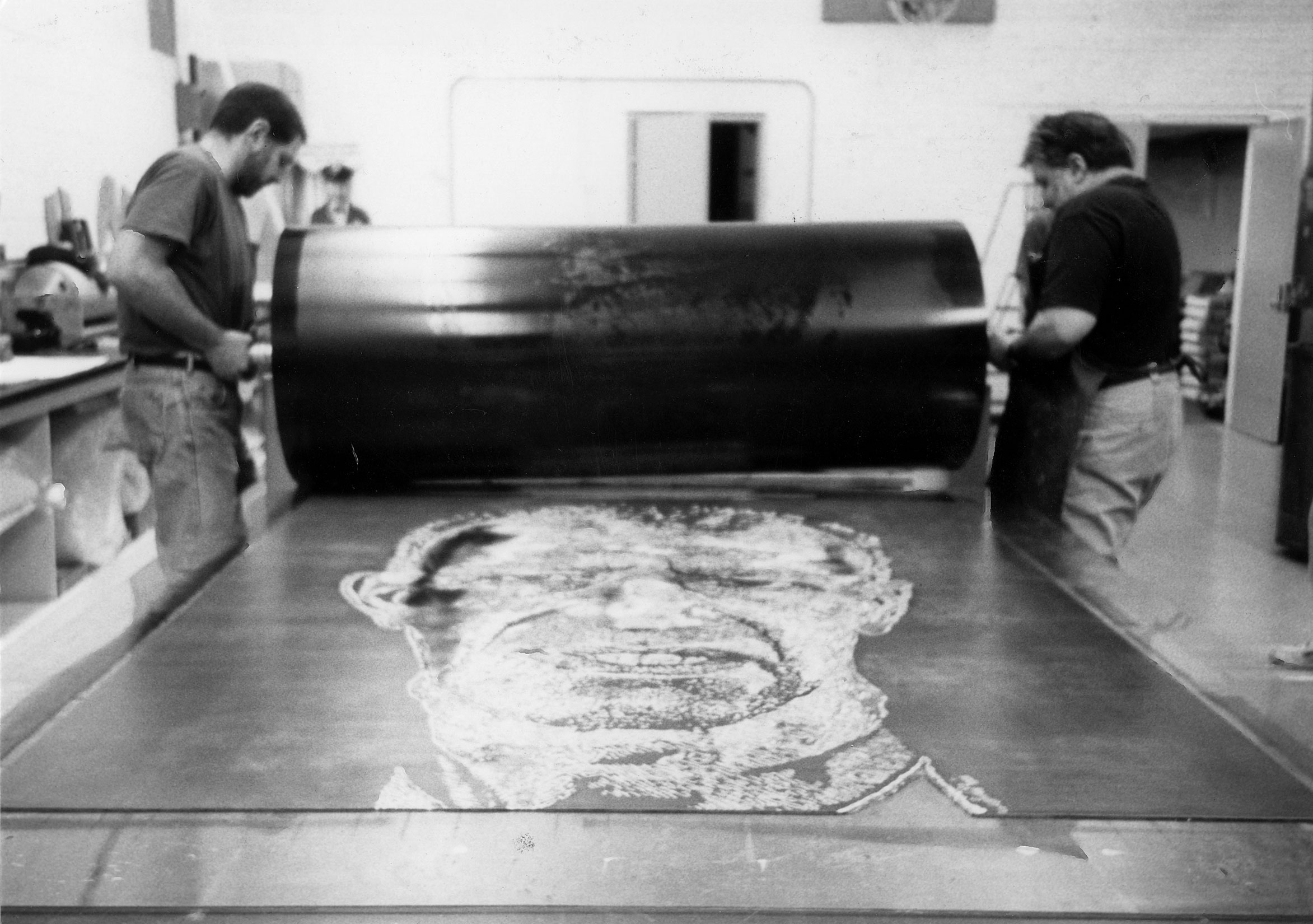 Joe Wilfer and Andy Rubin inking the linoleum block for 'Alex/Reduction Print' at Tandem Press, 1993 (Photo by Miriam Hill)