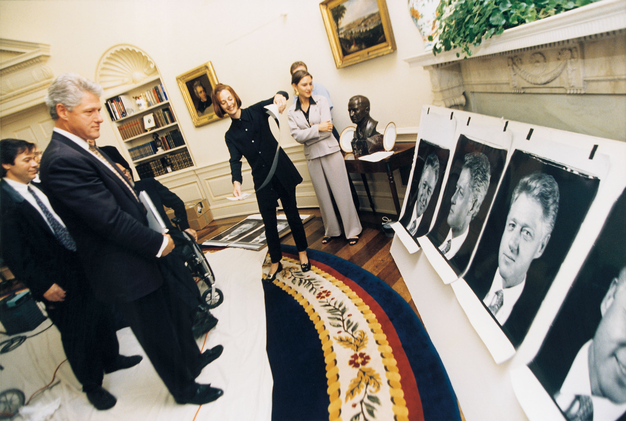 Bill Clinton looking at his Polaroids in the White House, 1996 (Photo by Official White House Photography)
