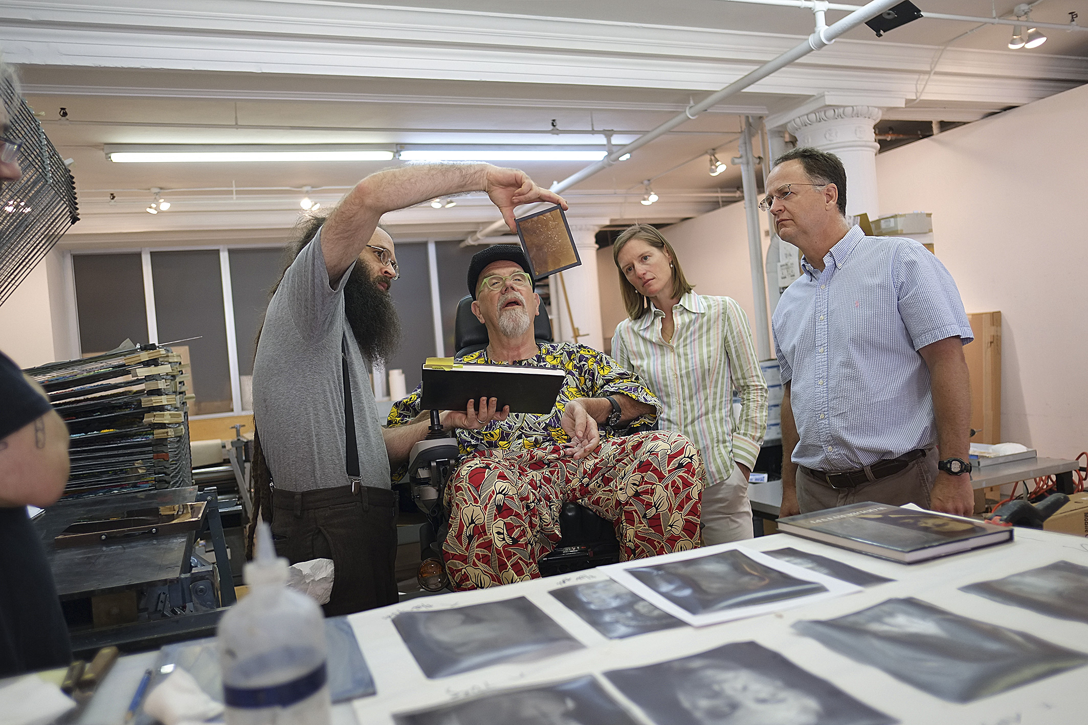 Barret Oliver, Chuck Close, Evelyn Lasry, and David Lasry reviewing the 'Brad, 2012' gelatin film (Photo by Terrie Sultan)